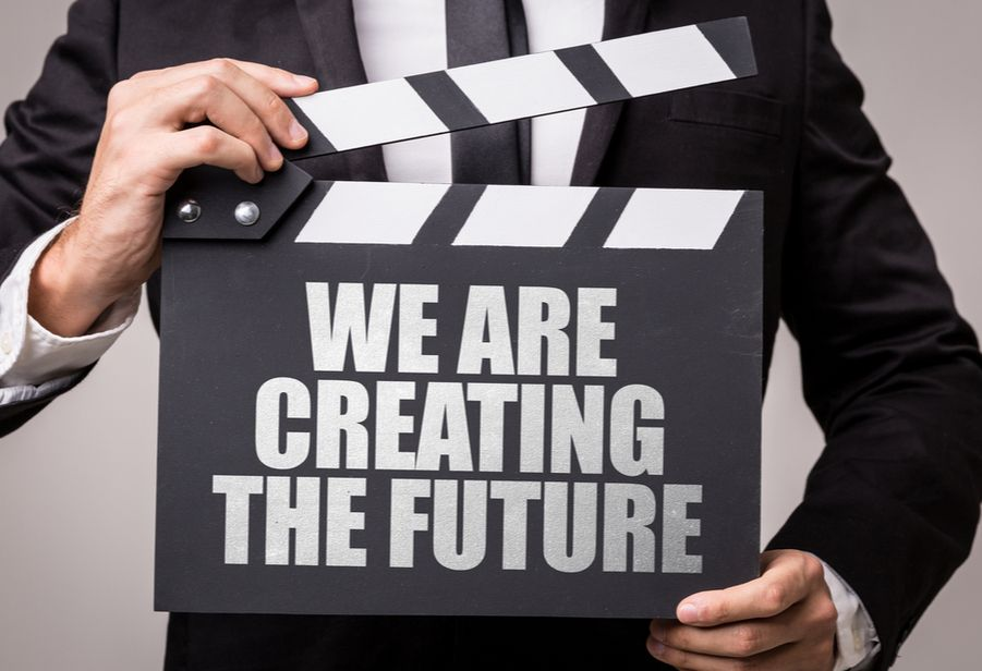 Find quality business leads. Business mena holding post saying we are creating the future.