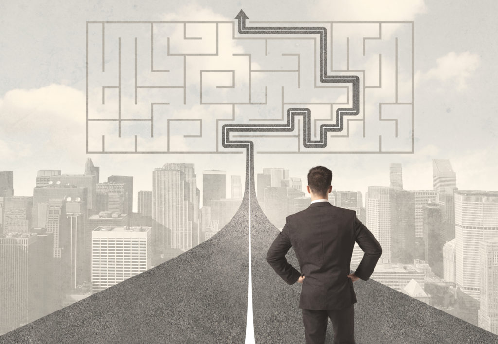 Business man staring at path through maze: B2B sales call guide