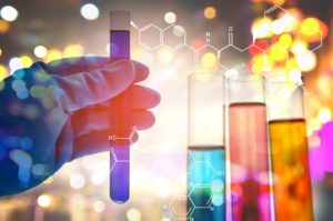 Quality Leads for tech companies man gloved hand holding test tube.